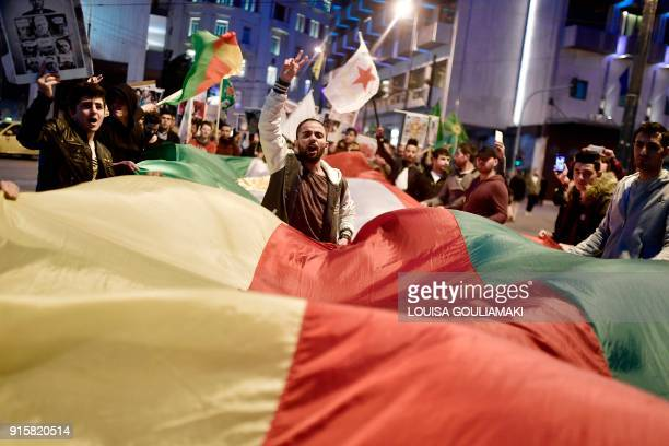 TOPSHOT A man flashes a victory sign as Kurds living in Greece take part in a demonstration towards the Turkish embassy in Athens on February 8 2018...