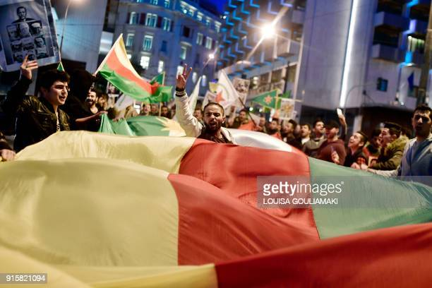 A man flashes a victory sign as Kurds living in Greece take part in a demonstration towards the Turkish embassy in Athens on February 8 2018 against...