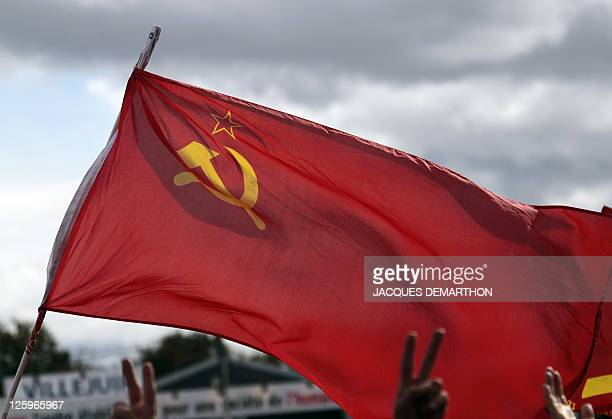 A man flashes the victory sign as he listens to the final speech of the Fete de l'Humanité a political event organized by French communist party on...