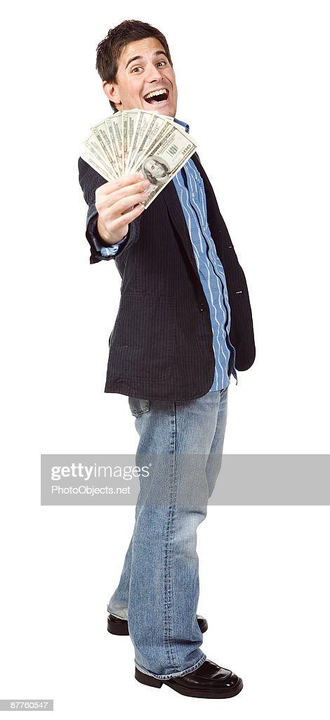 Man flaunting money : Stock Photo