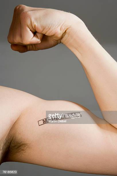 A man flexing his bicep stamped