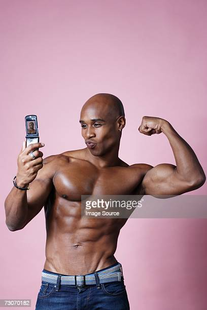 Man flexing his muscles for camera