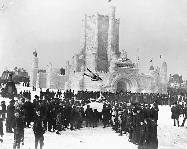 A man flies high in the air to the cheers of revelers during blanket tossing at the St Paul Winter Carnival