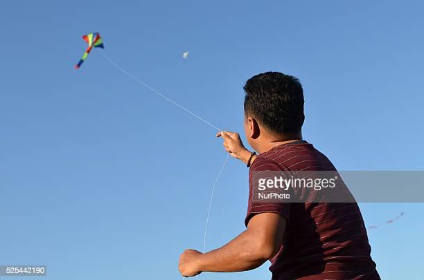 Man flies his kite during the Kite Festival at Sanam Luang in Bangkok, Thailand on April 18, 2015. The Kite Festival hold on 17-21 April, to...