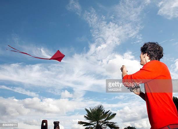 Man flies kite