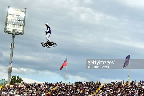 A man flies with a drone before the Italian Serie A football match Fiorentina vs Napoli on April 29 2018 at Artemio Franchi stadium in Florence