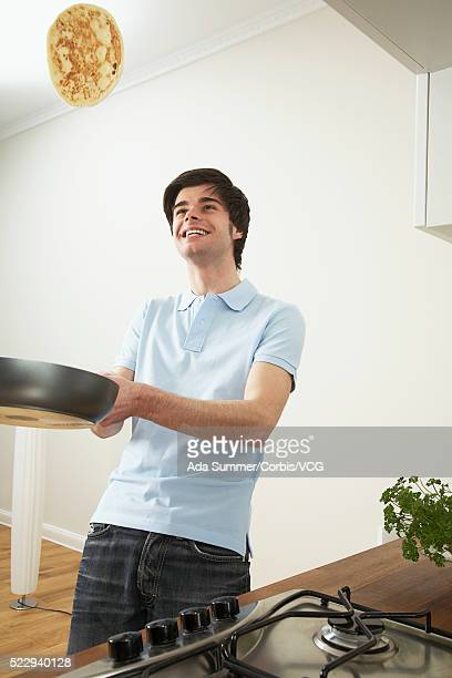 Man flipping pancake