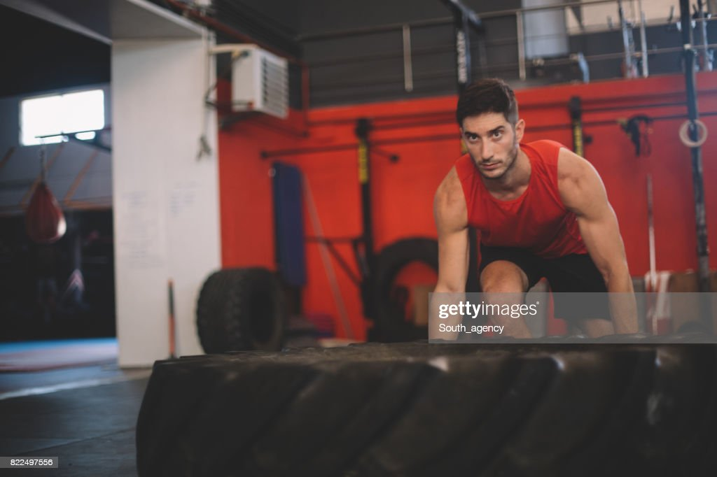 Man flipping tire at the gym : Stock Photo