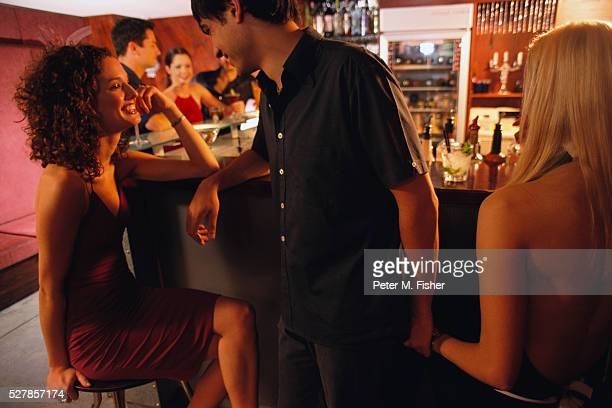 man flirting with two women - flirting stock pictures, royalty-free photos & images