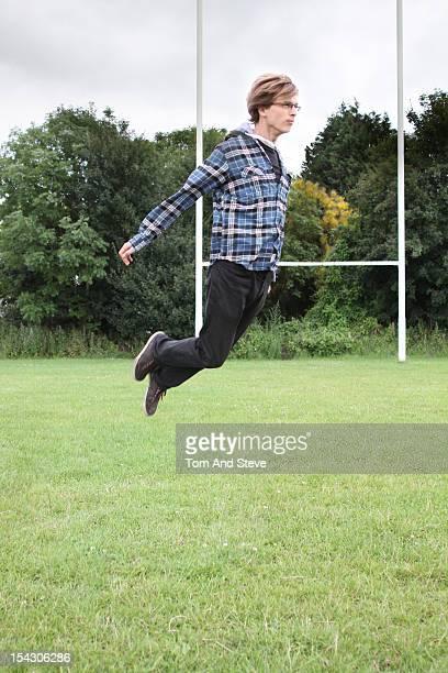 A man floating in a field