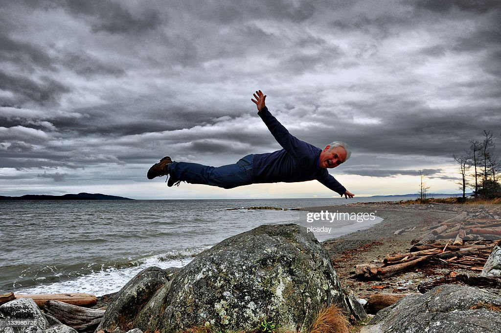 Man Floating In Air Stock Photo