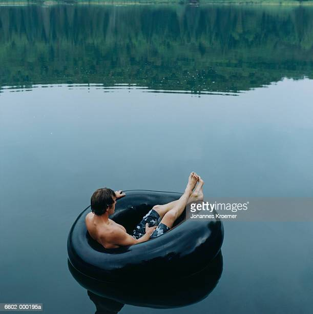 Man Floating in Inner Tube