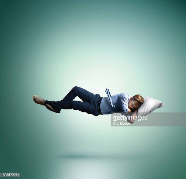 Man floating in mid-air, sleeping