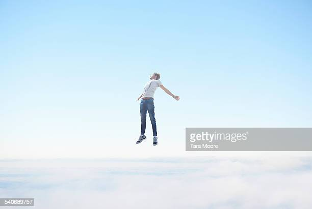 man floating in sky - freedom stock pictures, royalty-free photos & images