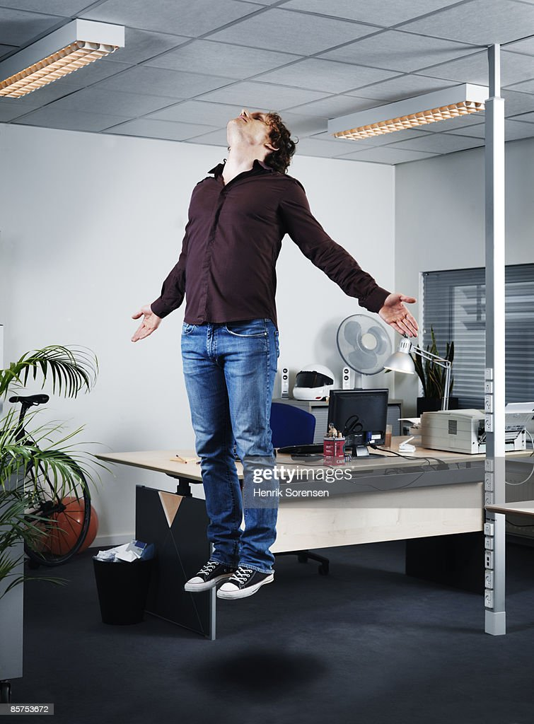 Man Floating In The Air His Offiice Stock Photo