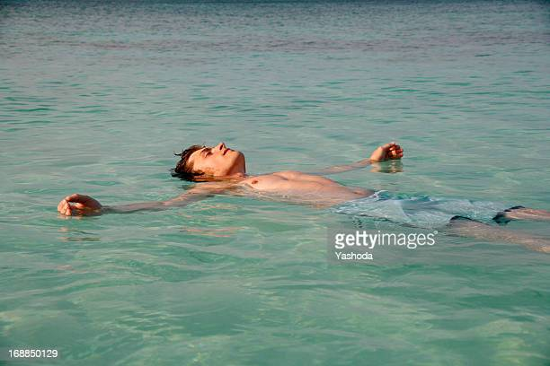 Man floating in tropical water