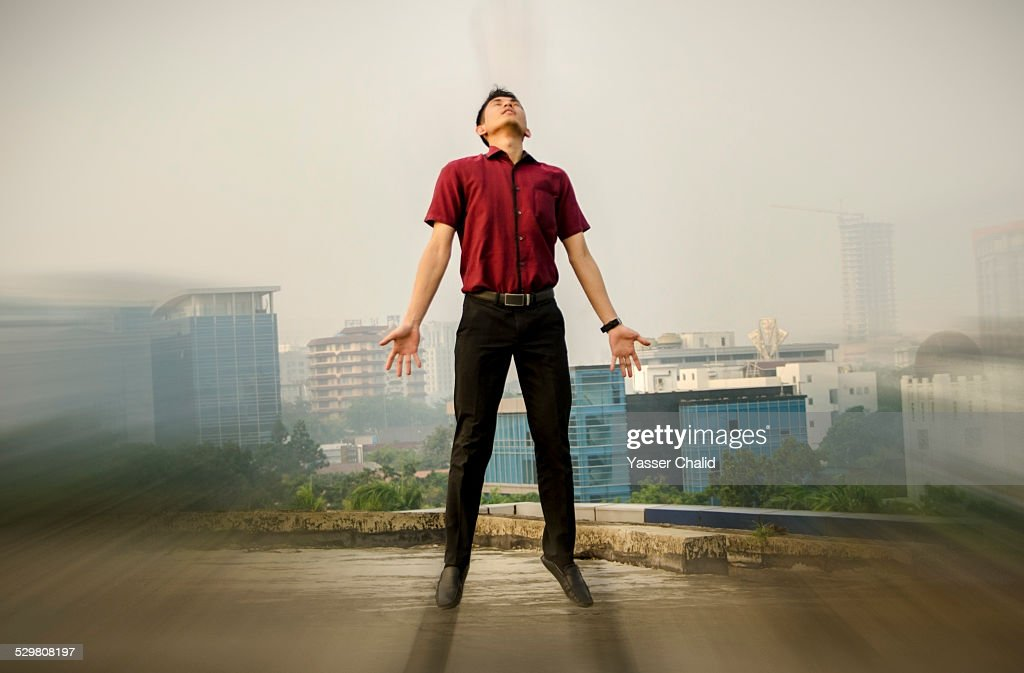 Man Floating On Air Stock Photo