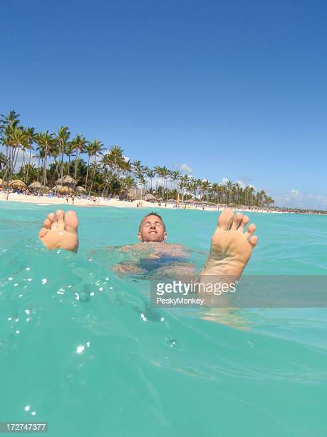 Man Floats in Tropical Turquoise Waters