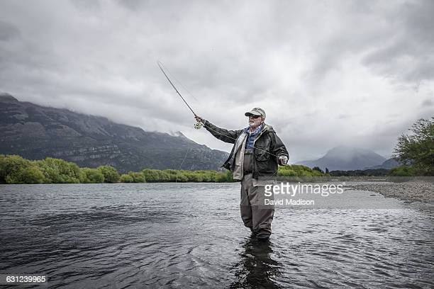 man fly fishing in patagonia - fishing industry stock pictures, royalty-free photos & images