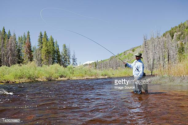 Man fly fishing in river, Colorado, USA