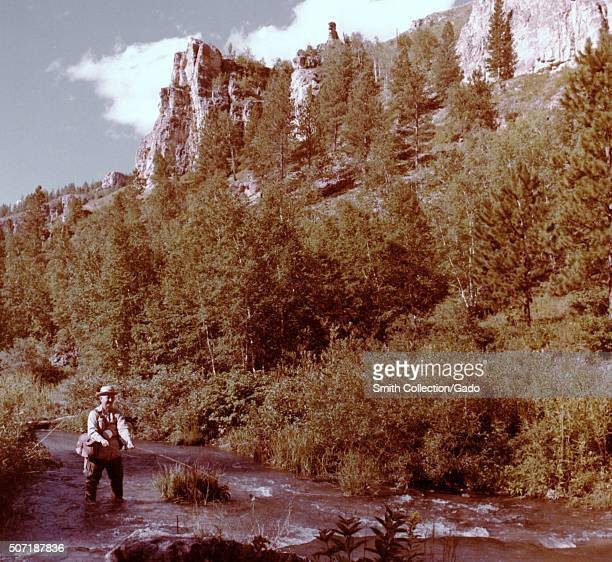 Man fly fishing in Spearfish Canyon Black Hills South Dakota 1975