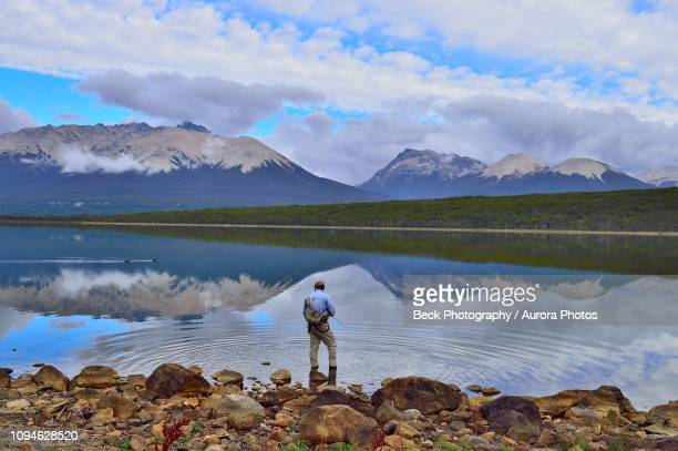 man fly fishing in tres valles lake, argentina - três pessoas stock pictures, royalty-free photos & images