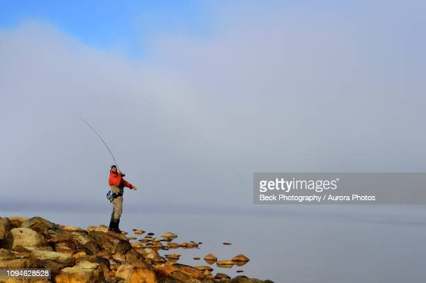 man fly fishing intresvalleslake, argentina - três pessoas stock pictures, royalty-free photos & images