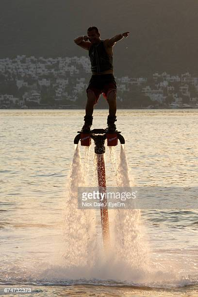 Man Flyboarding In Sea