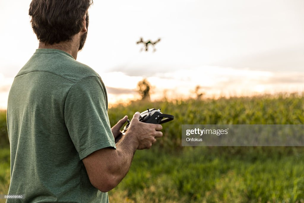 Man Flying a Drone at Sunset : Foto de stock