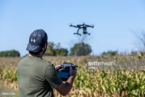 Man Flying a Drone  Over Corn Field