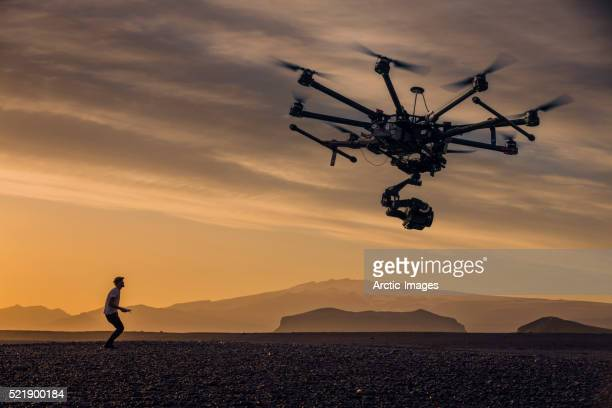 Man flying a drone, photographing the Icelandic landscape, Iceland