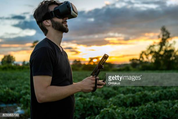 Man Flying a Drone with Virtual Reality Goggles Headset