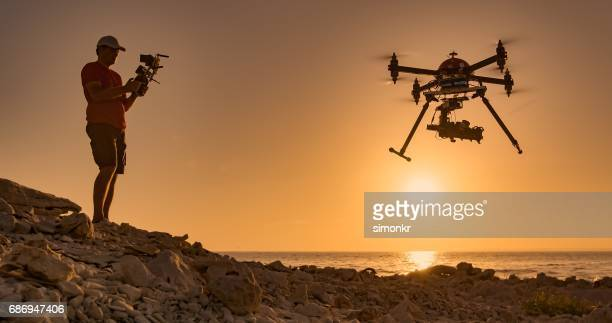 man flying drone - remote controlled stock photos and pictures