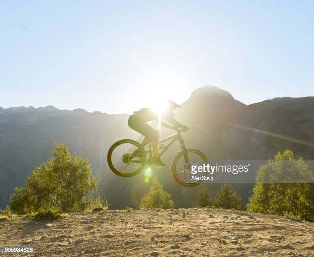 Man flying in midair with mountain bike