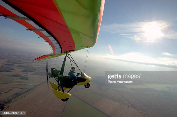 man flying in ultralight - aereo ultraleggero foto e immagini stock