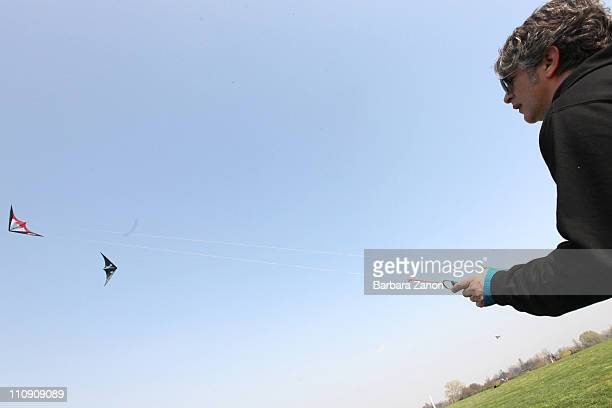 A man flys his kite during the first 'Festival of Spring and North Winds' kite festival at Parco San Giuliano on March 26 2011 in Mestre Italy Many...