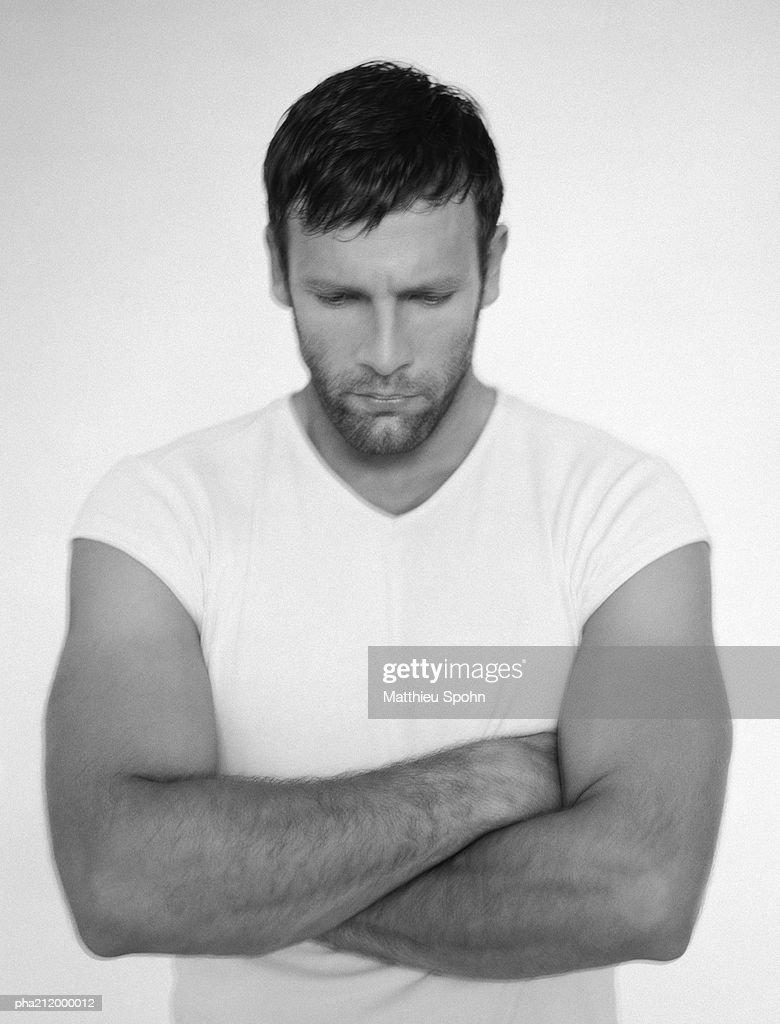 Man folding arms, portrait, b&w. : Stock Photo