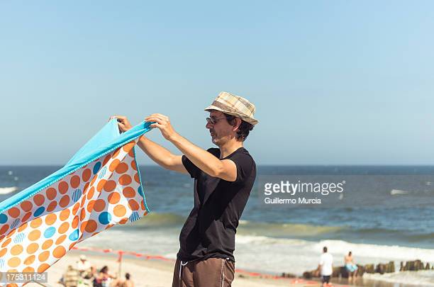 Man folding Beach Blanket