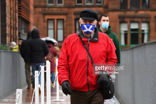 Man follows a one-way queuing system as he arrives to vote at a polling station at a school in Scottish Parliament elections in Glasgow on May 6,...
