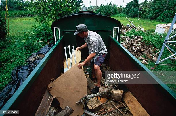 man foraging for fuel, rarotonga, cook islands - pacific islands stock pictures, royalty-free photos & images