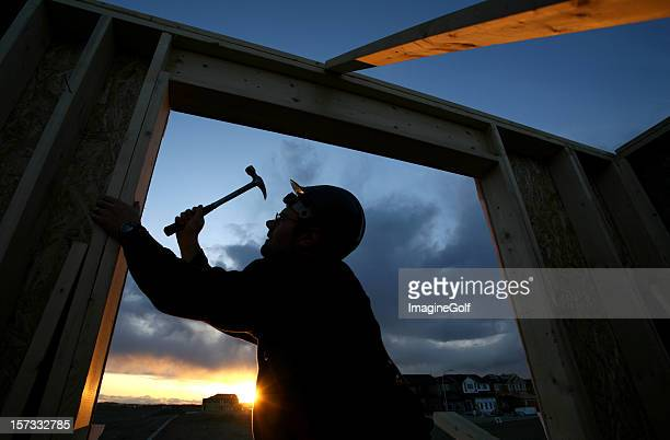 Man Framing Out Window at Residential House