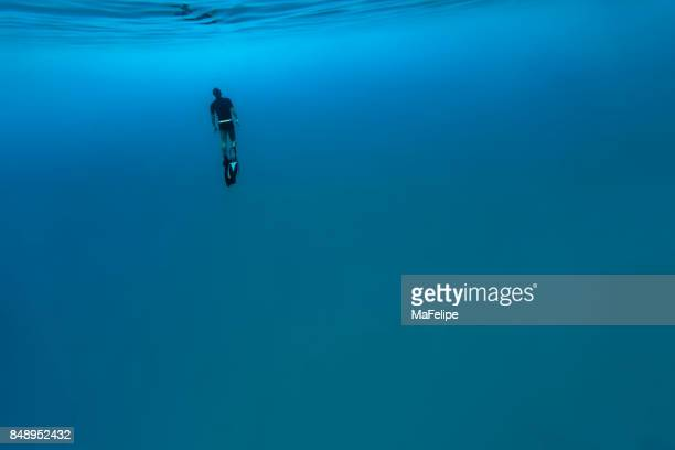Man free diving in Fernando de Noronha