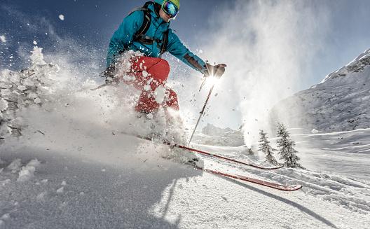 Man freerideer running downhill 506515974