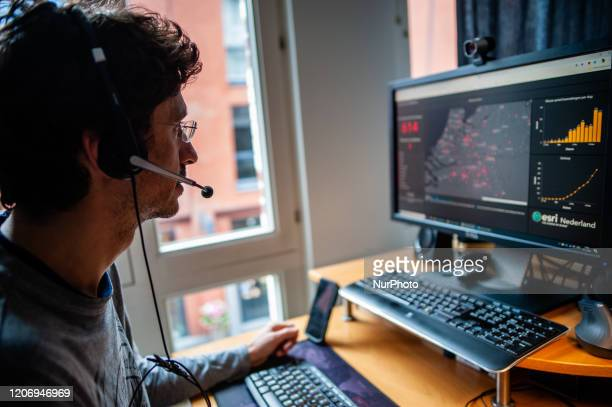A man from a company based in North Brabant is working from home and watching the Coronavirus statistics during the Coronavirus crisis in The...