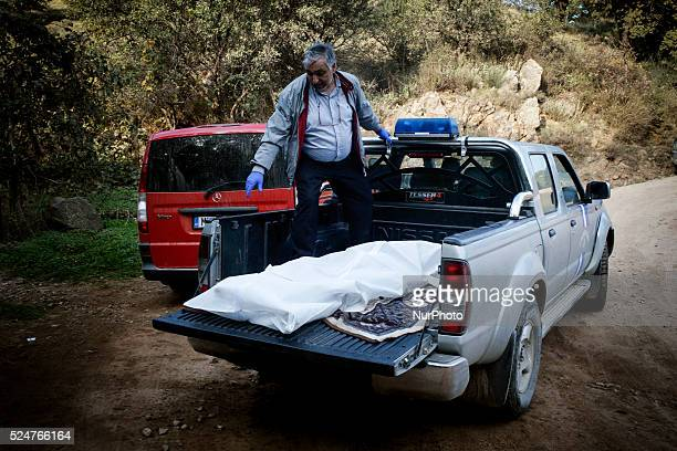 A man from a funeral office takes a dead body off the back of the Hellenic Coast Guard's truck near Eftalou Lesbos November 6 2015 Lesbos lies on the...
