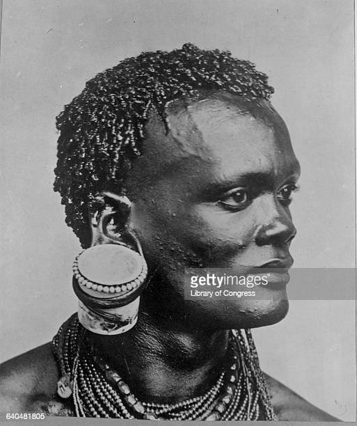 A man from a Kenyan tribe wears a giant decorative plug in his earlobe