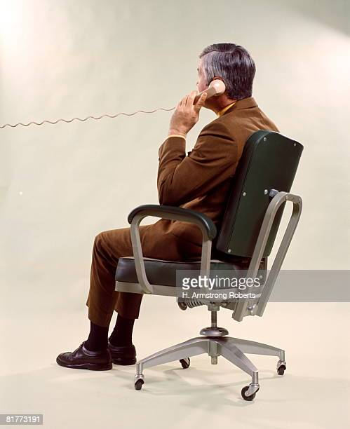 Man From Back Seated Metal Office Chair Talking On Telephone Men Business Businessman Businessmen.