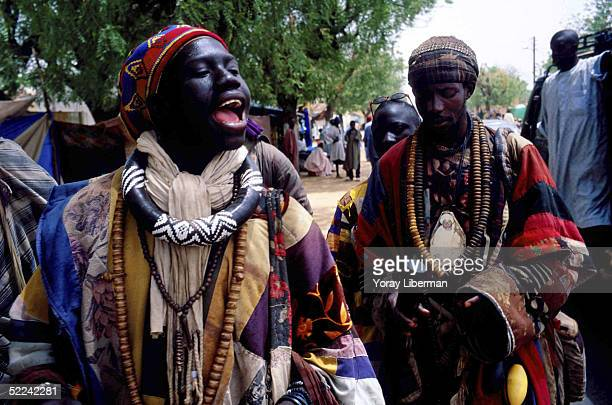 A man from Baye Fall sings in the streets of Mbake during the Magal De Touba April 23 2003 in Mbake Senegal The Mouride Baye Fall community in...