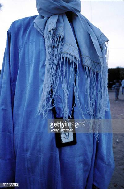 A man from Baye Fall wears a picture of his Marabou on his neck April 22 2003 in Mbake Senegal The Mouride Baye Fall community in Senegal celebrates...