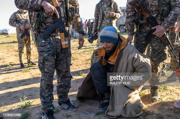 TOPSHOT A man from Bosnia suspected of being an Islamic State group fighter is searched by members of the Kurdishled Syrian Democratic Forces after...